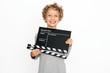 kleiner Junge mit Filmklappe