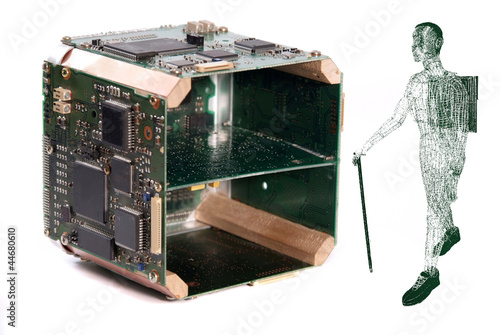 Man carrying a laptop past computer components