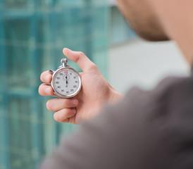 Man Holding A Stopwatch