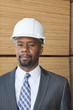 Portrait of an African American male engineer with wooden planks in background