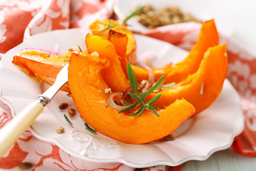 Baked pumpkin with garlic, olive oil and rosemary.