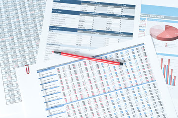 pen over financial reports