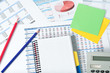 financial documents with notebook and pencils