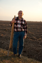 farmer with spade and pitchfork