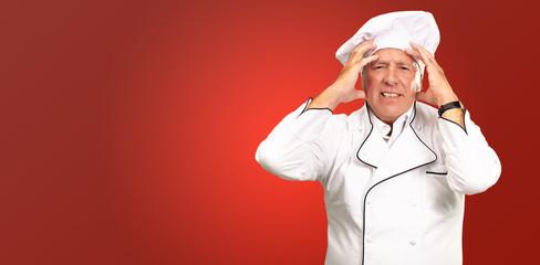 Portrait Of A Chef Having Headache