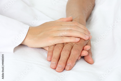 Patient hand in bed