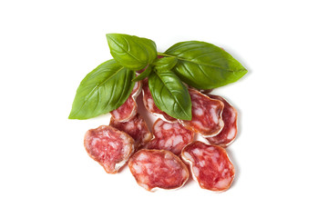 Salami isolated with herb basil