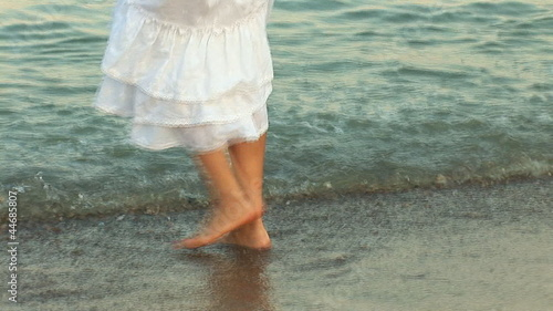 woman in white dress walking on the waves