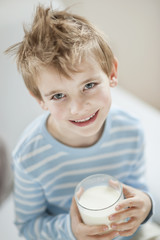 Portrait of happy young boy drinking milk