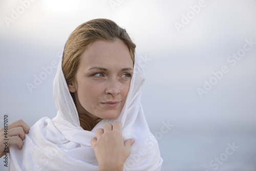 woman with head scarf on the beach