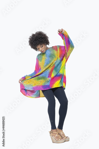 Full length of an African American woman in dashiki over gray background