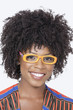 Portrait of an African American woman wearing glasses over gray background