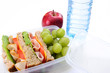 wholemeal healthy sandwich in lunch box and water bottle