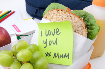 Healthy lunchbox with wholemeal sandwich and note from mom