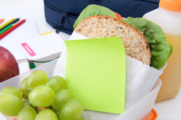 Healthy lunch box with sandwich and post it note message