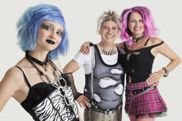 Group portrait of young female punk with senior couple standing in background