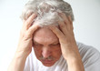 senior man holds his head in despair