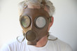 old gas mask worn by senior man