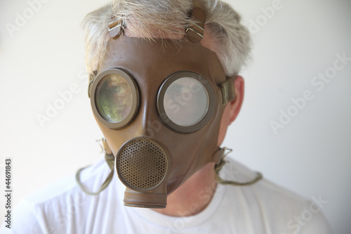 old gas mask worn by senior man
