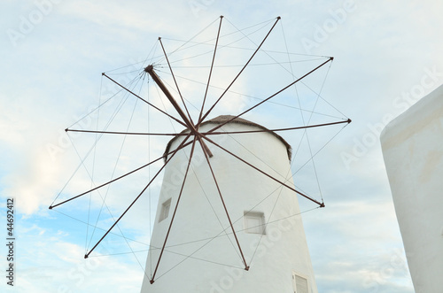 Wind turbine generating electricity on white building