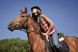 Cowgirl riding a bay horse poster