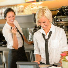 Cafe waitress cashes in order bill register