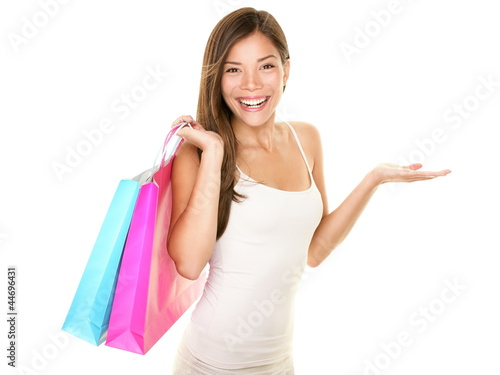 Shopping woman showing