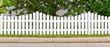 Leinwanddruck Bild - Weißer Gartenzaun