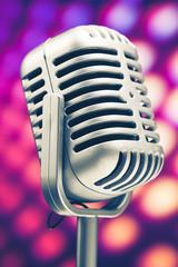 retro microphone on purple disco background