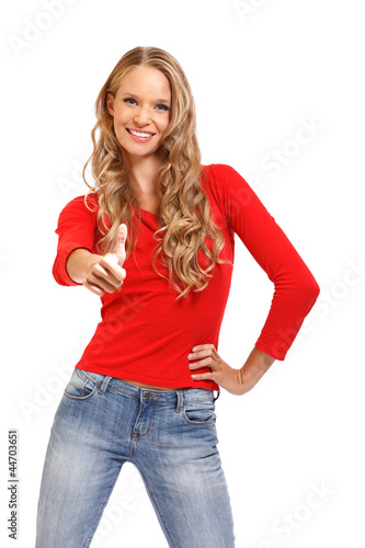 portrait of a happy young woman with thumb's up sign