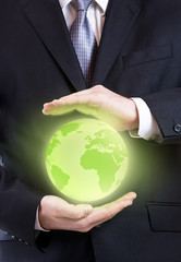 Business man holding a planet close up