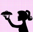 Silhouette of woman holding serving tray