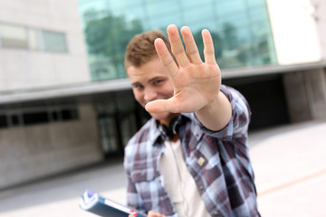 Student showing hand towards camera