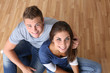 Upper view of young couple sitting on the floor