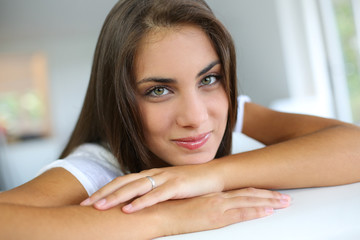 Portrait of beautiful girl sitting in sofa