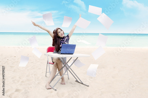 Young asian businesswoman expressing her success at beach