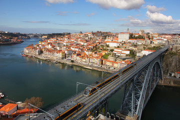 Train over Dom Luis I bridge, Porto, Portugal