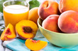 fresh peaches and glass of juice