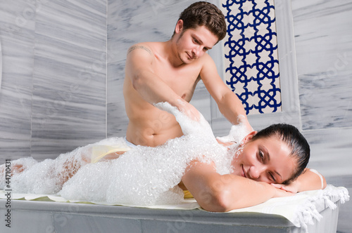 Bath attendant massages and bathes adult woman