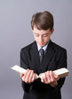 Boy reading from the Bible