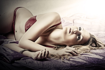 Young sexy woman on a bed