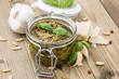 Glass with fresh made Pesto Sauce