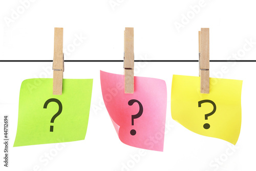 Note Papers with Question Marks Hanging on Clothesline