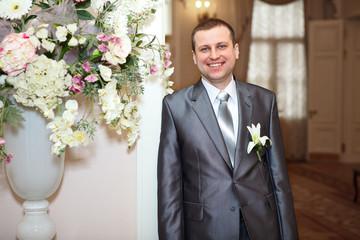 Haapy smiling groom indoor portrait
