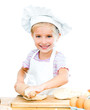 Little girl makes dough