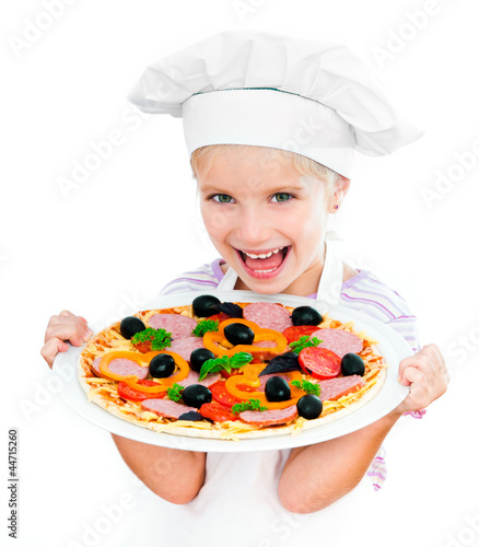 little girl preparing a pizza