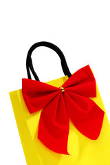 Yellow bag with red bow
