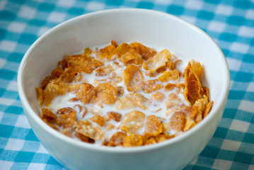 Bowl of cornflakes and milk for breakfast