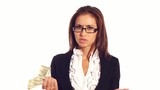 Sad businesswoman throws dollars, finance problem