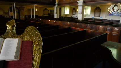 A bible on a bronze eagle lectern in an old church.
